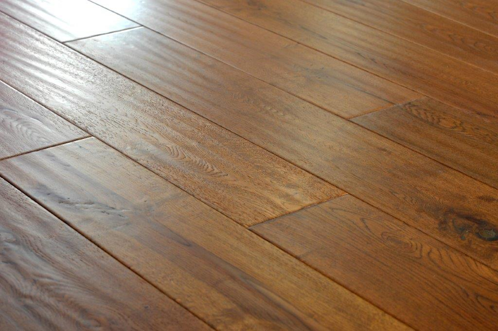 What are the different finishes on solid & engineered wood floors?